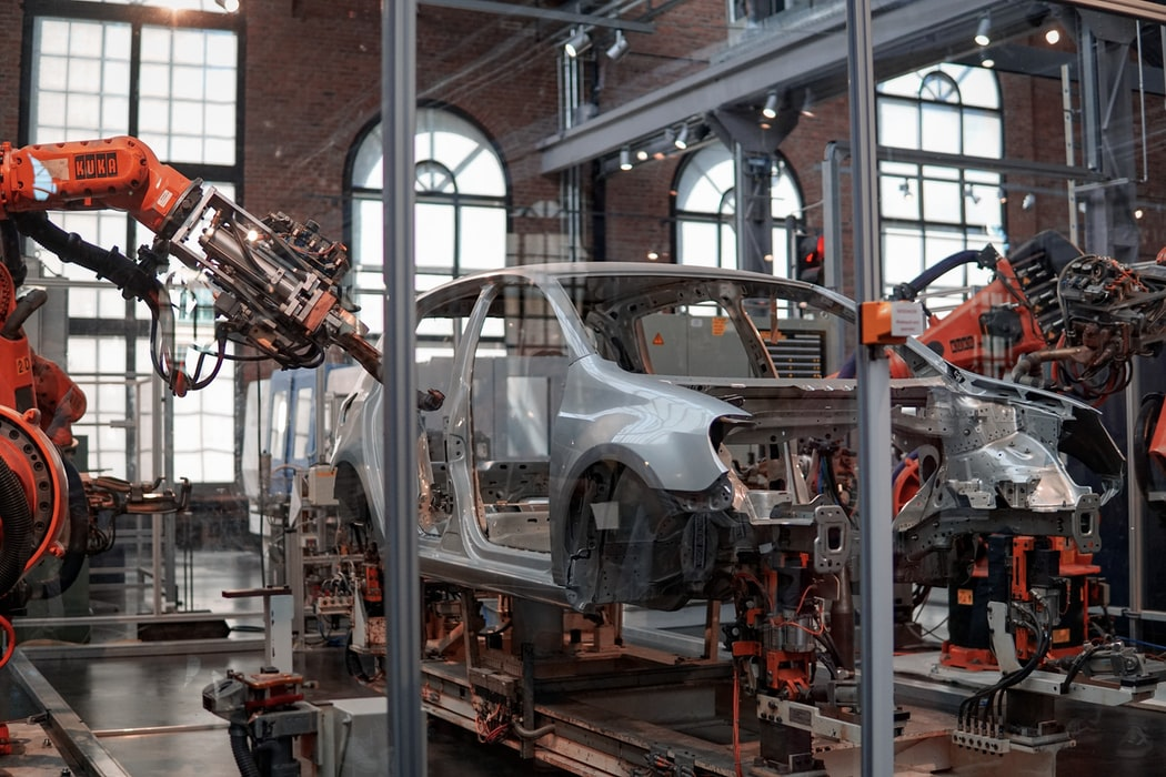 future-of-sales--gray-vehicle-being-fixed-inside-factory-using-robot-machines